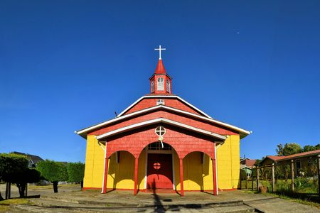 woodcraft: Historic wooden churches were built in the 17th century by Jesuit missionaries on the island of Chiloe in Chile. Stock Photo