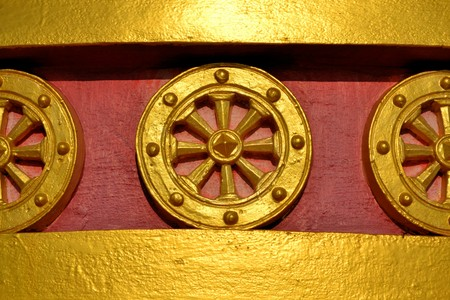 doctrine: Golden Buddhist wheel of the law or dhamma cakka is a symbol for Buddhism