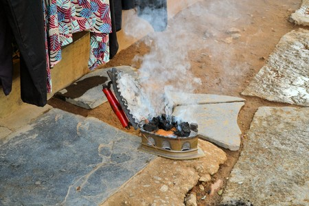 third world: Charcoal irons are still in use for laundry in third world countries like India Stock Photo