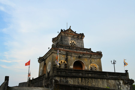 watch city: A gate with a watch tower at the Imperial City in Hue, Vietnam. The citadel was oriented to face the Huong River to the east.  Stock Photo