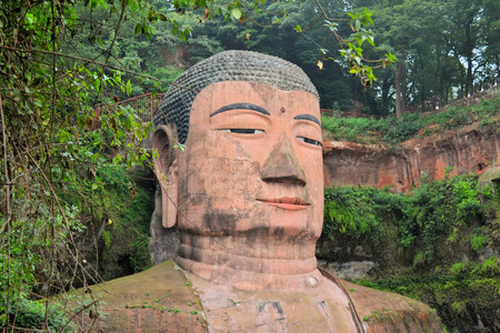 chuan: The Leshan Giant Buddha, the largest stone Buddha in the world and it is by far the tallest pre-modern statue in the world in Mount Emei, Sichuan, China