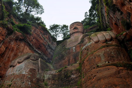 subdue: The Leshan Giant Buddha, the largest stone Buddha in the world and it is by far the tallest pre-modern statue in the world in Mount Emei, Sichuan, China