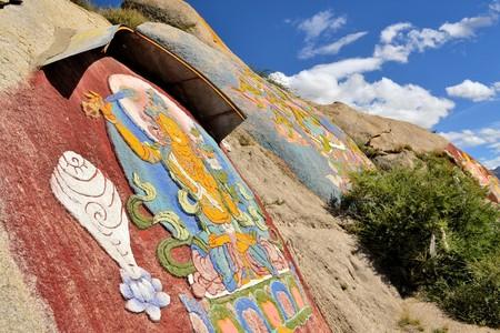 gelugpa: Tibetan prayer stone paintings of Mahayana Buddhist depictians in the mountains of Lhasa, Tibet