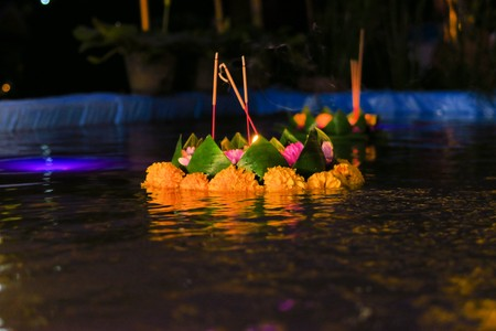 swimming candles: Small floating Krathong with candles and flowers are floated in rivers and ponds for Thailands traditional Loy Krathong Festival