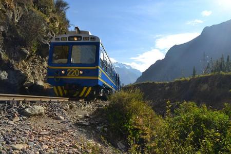 Peru Rail train in Urubamba river valley from Cuzco via Ollantaytambo to Machu Picchu