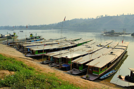 indochina: Boats on beautiful Mekong river in Laos. Mekong is one of the most important river in Indochina and South East Asia