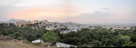 A view of Udaipur city palace at the shores of Pichola lake in Udaipur, Rajasthan, India Stock Photo