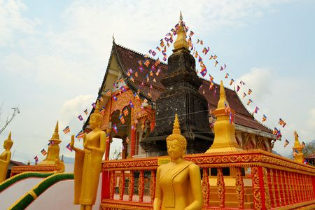rural town: Beautiful Buddhist temple Wat That in the small rural town of Vang Vieng, Laos