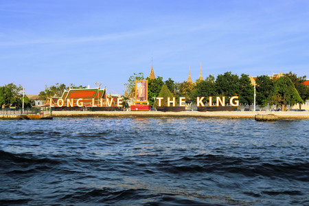 constitutional: Long live the King reads a sign along the Chao Phraya river to commemorate the birthday of the king of the constitutional monarchy of Thailand. Many Thai people are enamored with their King Bhumipol.