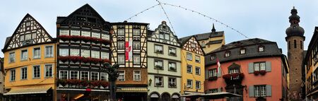 fachwerk: Traditional half-timbered houses in Fachwerk architecture on market square in medieval town Cochem, Mosel region, Germany Stock Photo