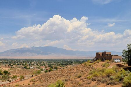 House in Adobe architecture typical for Native New Mexico ioverlooking Albuquerque and the Sandia mountains, NEw MExico, USA