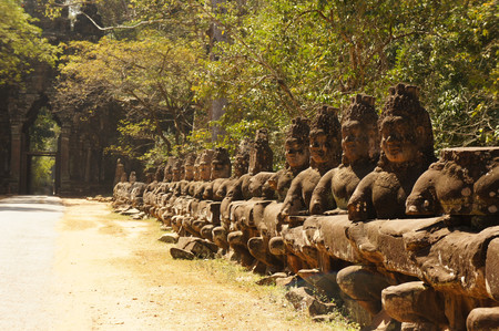 east gate: East gate to angkor thom in Cambodia is lined with warriors and demons
