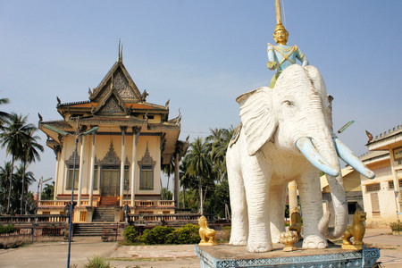rural town: Modern Buddhist temple with elephant rider statue in rural town of Battambang, Cambodia