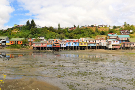 castro: Palafitos in Castro. Castro is the capital of Chiloe Province, in the Los Lagos Region, Chile. Palafitos are houses raised on piles over the surface of the soil or a body of water