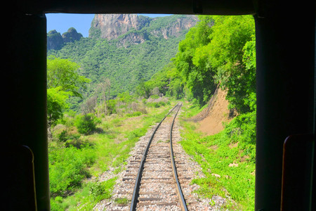 chihuahua desert: An eastbound Mexican passenger train winds its way up thr Copper Canyon, climbing 6500 in a matter of 150 miles Stock Photo