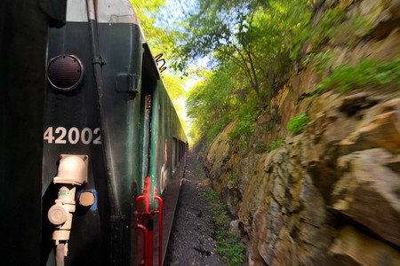 chihuahua desert: An eastbound Mexican passenger train winds its way up thr Copper Canyon, climbing 6500 in a matter of 150 miles Editorial