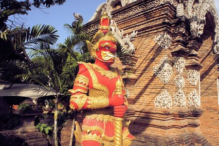 molee: Standing Buddhist  Gnome at Wat Lok Molee. Buddhist temple decoration in Chiang Mai, Northern Thailand