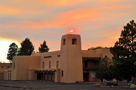 A church at sunset during a forest fire in the city of Santa Fe, New Mexico
