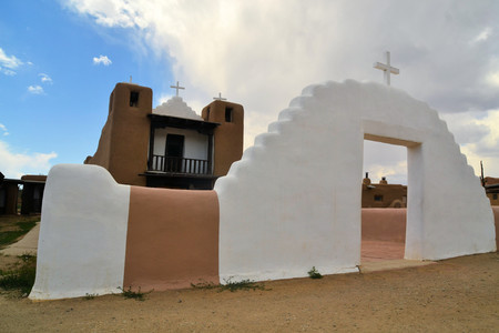 adobe pueblo: Little Christian church in Taos Pueblo ancient Indian indegineous adobe city in New Mexico Stock Photo