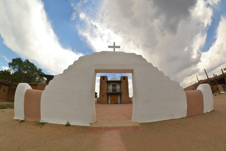 Little Christian church in Taos Pueblo ancient Indian indegineous adobe city in New Mexico Stock Photo