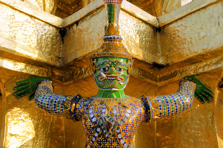 telamon: Warrior statue supporting the weight of a stupa at the temple Wat Phra Kaeo. Bangkok. Thailand Stock Photo
