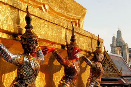 atlantes: Warrior statue supporting the weight of a stupa at the temple Wat Phra Kaeo. Bangkok. Thailand Stock Photo