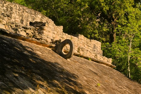 predecessor: Carved stone hoop at the Great Ball Court Maya Site Coba, Yucatan, Mexico. The Mayan ball game was a predecessor to modern basketball Stock Photo