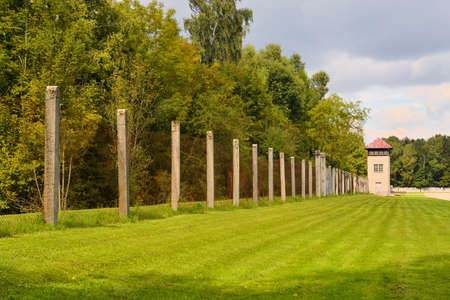 perimeter: Fence and watch tower on the perimeter of the Dachau concentration camp near Munich, Bavaria, Germany
