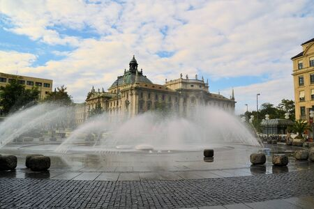 waterspout: Stachus fountain on Karlsplatz in Munich with view to the Palace of Justice, Bavaria, Germany