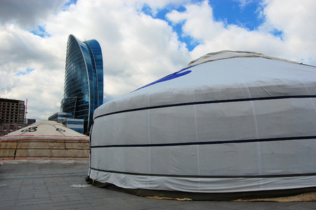 Mongolian Ger Tents on Chinggis Khaan Square during Nadaam Festival. Sukhbaatar Square with cityscape in the background