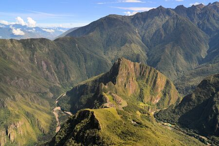 lost city: Aerial view from way above as seen from Machu Picchu mountain. Machhu Picchu is the famous lost city of the Incas near the river Urubamba located in the region of the sacred valley of Cuzco. Machu Picchu is a UNESCO world heritage site and one of the 7 ne Stock Photo