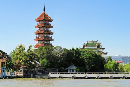 water scape: Traditional Chinese temple pagoda on embankment of Chao Phraya, Bangkok, Thailand. There is a sizable amount of Chinese immigrants in Bangkok. Editorial