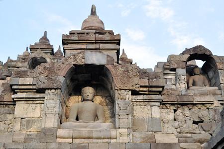 Buddhas in giant Buddhist Borobudur Temple monolith in the Prambanan Plain near Yogyakarta, Java, Indonesia. photo