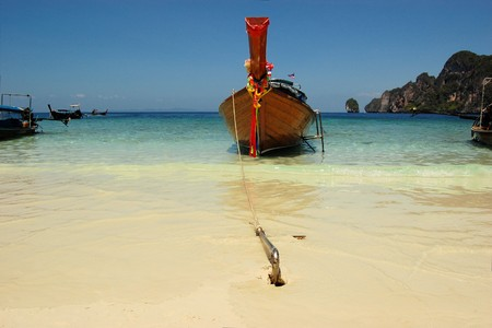 longtail: Traditional Longtail boat on the Loh Dalum beach, Phi-Phi Don island,  Thailand