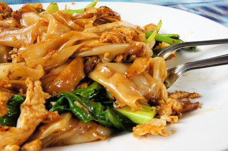 south east asian: Pad See Ew, is a typical South East Asian noodle dish made up of flat rice noodle stir fried with beef.