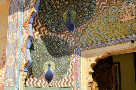 Art work showing a colorful Peacock in City Palace of Jaipur, Rajasthan, India
