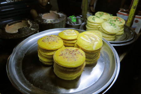 calories poor: Traditional Burmese street food pancakes with different ingredients like coconut or herbs in Yangon,Burma