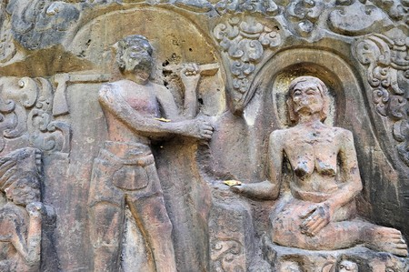 Yeh Pulu is a famous carved cliff face dating back to the 15th century depicting daily scenes in Ubud, Bali, Indonesia Standard-Bild