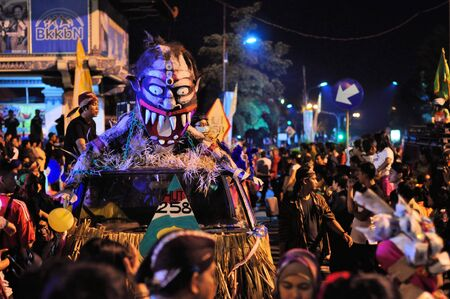 creatively: Yogyakarta, Indonesia - 7 October 2014:  258th city anniversary - Car is creatively decorated to look like a mask, running in a parade to celebrate tradition and unity at Marlioboro Street, Kota Yogyakarta