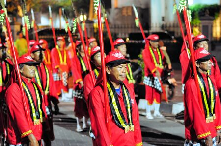 Yogyakarta, Indonesia - 7 October 2014:  258th city anniversary - Men traditionally dressed as guards of the sultan march in a parade to celebrate tradition and unity at Marlioboro Street, Kota Yogyakarta