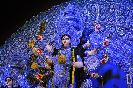 durga: Kolkata, India - 9 October 2013:  An idol of revered goddess Durga standing in an unidentified pandal in the city of Kolkata during Durga Puja festival. A pandal is a temporary temple, erected during the week long religious festival of Durga Puja, one of