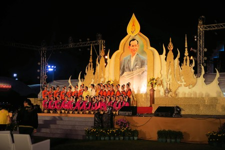 adulyadej: Bangkok, Thailand - 2 December 2014: Performers on stage to celebrate the 87th birthday of His Majesty King Bhumibol Adulyadej at the royal field Sanam Luang adjoining the Grand Palace, Rattanakosin Central Bangkok