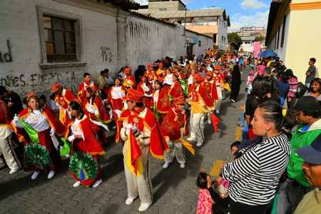 supposedly: Latacunga, Ecuador 30 September, 2012: A parade march during La Fiesta de la Mama Negra traditional festival.  Mama Negra Festival is a mixture of indigenous, Spanish and African influences and celebrates the patron saint Virgen de la Merced supposedly st