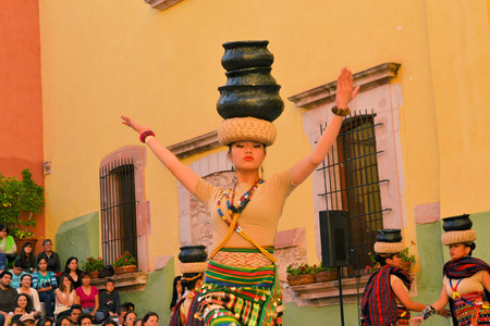 involving: Zacatecas, Mexico, 02 August 2013: Canadians with Philippino roots perform traditional Muslim dances involving the balancing of baskets from the Southern island of Mindanao at the 18th Festival Cultural Internacional Zacatecas del Folclor. It is the bigge Editorial