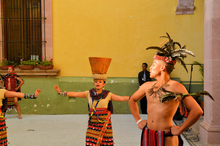 pinoy: Zacatecas, Mexico, 02 August 2013: Canadians with Philippino roots perform traditional Muslim dances involving the balancing of baskets from the Southern island of Mindanao at the 18th Festival Cultural Internacional Zacatecas del Folclor. It is the bigge Editorial