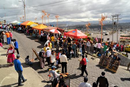 patron: Latacunga, Ecuador 30 September, 2012: Food stalls serve hearty pork dishes during La Fiesta de la Mama Negra traditional festival.  Mama Negra Festival is a mixture of indigenous, Spanish and African influences and celebrates the patron saint Virgen de l