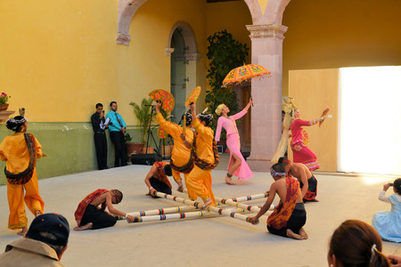 philippino: Zacatecas, Mexico, 02 August 2013: Canadians with Philippino roots perform traditional Muslim dances involving long bamboo sticks from the Southern island of Mindanao at the 18th Festival Cultural Internacional Zacatecas del Folclor. It is the biggest int