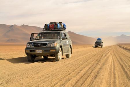 desert water: Uyuni, Bolivia - 28 November 2012: Tourist jeeps in Eduardo Avaroa National Park. Southwestern Bolivia is well-known for dramatic landscapes, lagunas, geysirs, desert and volcanoes Editorial