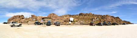 pescados: Salar Uyuni, Bolivia - 26 November 2012: Tourist Jeeps are stopping at Isla de Pescados in Salar Uyuni. A Jeep Tour through the Bolivian Salt Desert Uyuni is a popular touristic activity on the Altiplano in Bolivia