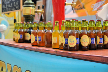 Puerto Varas, Chile - 20 January 2013: Bottles of local craft beer aligned in a row at Prosit fest, an Octoberfest style German festival in a beer tent in Puerto Varas. Descendants of German settlers are still practising their traditions in Southern Chile Editorial